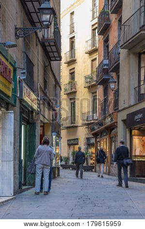 BARCELONA SPAIN - OCTOBER 23 2015: Narrow street in gothic quarter of Barcelona the capital city of the autonomous community of Catalonia in the Kingdom of Spain
