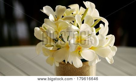 Bouquet of white and yellow plumeria A bouquet of plumeria serves as a beautiful centerpiece for special occasions
