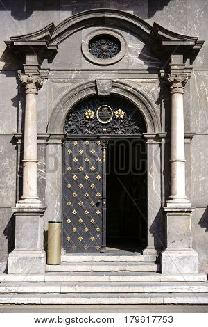 MAINZ, GERMANY - MARCH 24: The entrance door of the museum in the electoral palace of Mainz with its gold ornaments and coat of arms on March 24 2017 in Mainz.