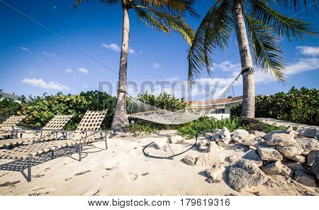Hammock and beach chairs in the  Caribbean