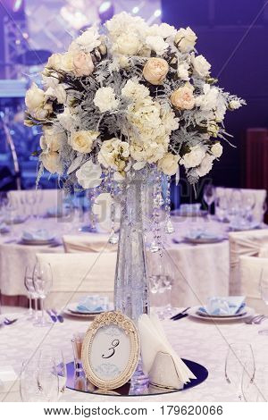 Luxury Wedding Decor Glass Vase With Flowers Of Roses And Hydrangea Closeup With Jewels. Arrangement