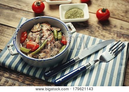 Bowl with tasty chicken marsala and vegetables on napkin