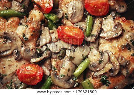 Delicious chicken marsala with vegetables, closeup