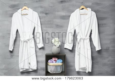 Bathrobes hanging on wall at spa salon
