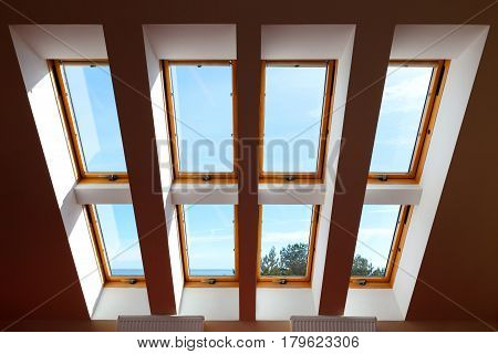 Construction of eight attic windows. Large luxury skylights. Roof windows