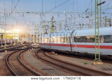 High Speed White Passenger Train On Railroad Track
