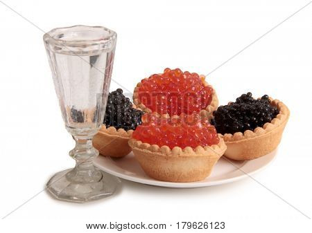 Fish caviar and glass of vodka on white background