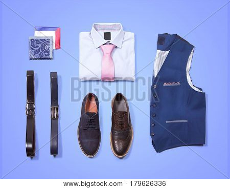 Men's office clothing. Shirt with tie, shawl, vest, belt and shoes