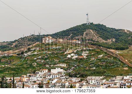 View of Ermita de San Miguel Alto with wall from Alhambra Granada Spain
