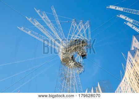 London, UK - November 30, 2016: Multiple exposure image of building construction site in the centre of London. Cranes and concrete contraction against of blue sky.