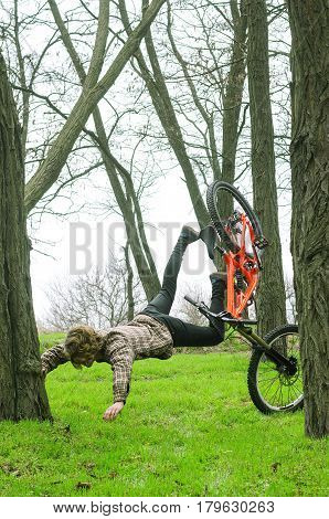 A Young Male Extreme Falls From A Bicycle.