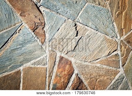 Background sandstone stone pavement of shapeless of pieces
