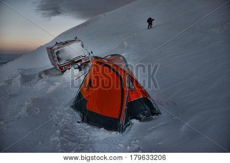 Tent and snowbound snowcat on the of Mount Elbrus