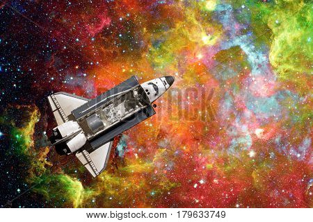 Space Shuttle flight over space nebula. Elements of this image furnished by NASA.