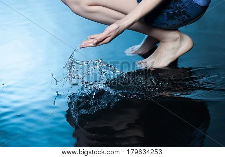 girl touch water