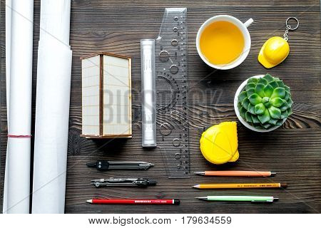 architect office with tools and cup in profession concept on wooden desk background top view