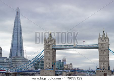The famous and iconic Tower Bridge in London with the city hall and the Shard skyscraper in the background.