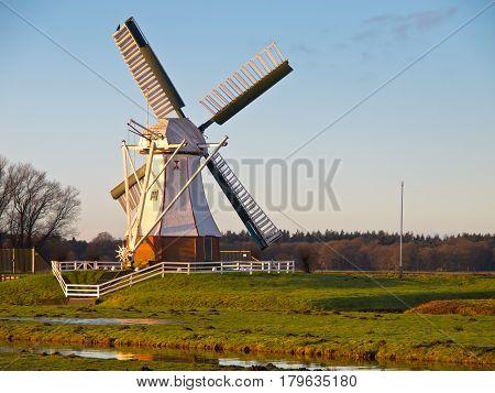 White Windmill Against Blue Sky