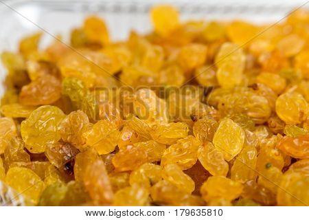 Organic dried golden raisins close up photo