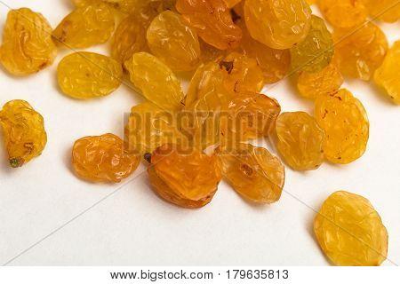 Macro photo of organic dried golden raisins on white background
