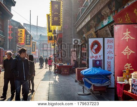 Tianjin, China - Nov 1, 2016: Tianjin Ancient Cultural Street, preserved in the classical Qing Dynasty architectural style. Morning scene to what is a very popular tourist area.