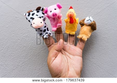 Male hand with the animal finger puppets.
