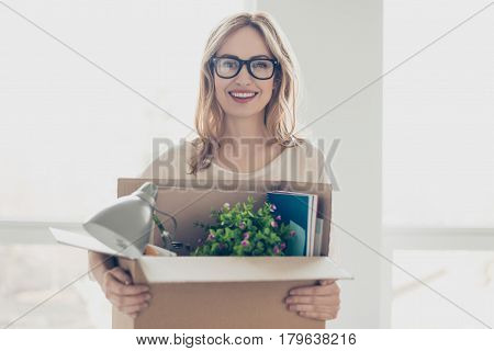 Concept Of Promotion At Work. Young Dreaming Pretty Smiling Woman In Glasses Holding Her Belongings