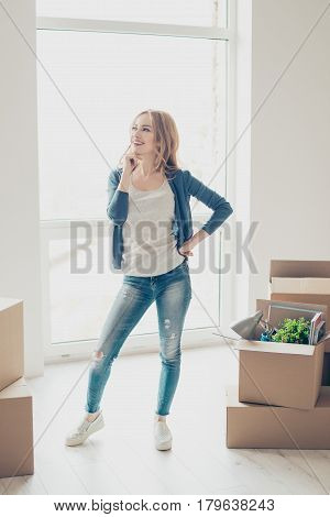Happy Smiling Woman Moving New House Of Her Dream And Thinking About Where To Put The Furtinure