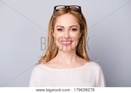 Portrait Of A Confident Cheerful Young Woman With Spectacles