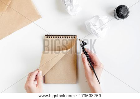 author office with hands in professional writer concept on white work desk background top view