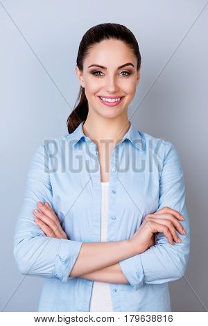 Vertical Portrait Of Pretty Young Manager In Formalwear Stnding With Crossed Arms Against Gray Backg