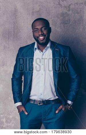 Portrait Of Handsome Bearded Afroamerican Man In Formalwear Holding Hands In Pockets