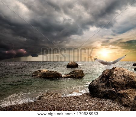 Storm clouds and lightning over the sea