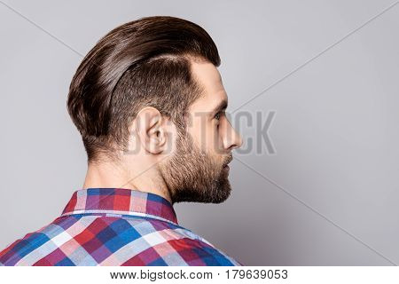A Half-face Portrait Of A Handsome Man With Modern Haircut Isolated On Gray Background