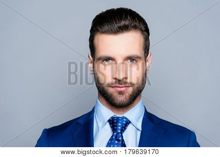 Portrait Of Serious Fashionable Handsome Man In Blue Suit Looking At Camera
