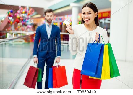 Attractive Happy Customers With Packets And Credit Card After Shopping