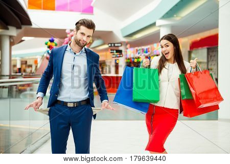 It's shopping and fun time. Cheerful successful happy young lovely couple
