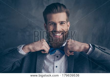 Portrait Of Stylish Hipster Young Man With Mustache, Beard And Beautiful Hairstyle Make Preparation