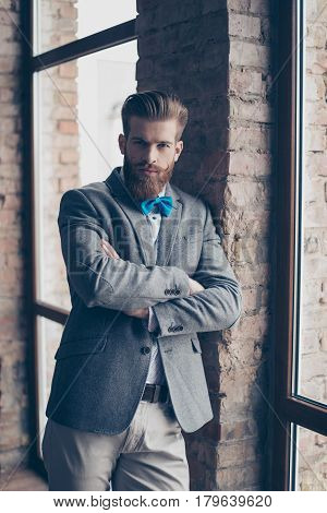 Portrait Of Stylish Hipster Minded Brutal Young Man With Bow-tie, Red Mustache, Heavy Thick Beard An