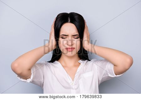 Angry Woman With Big Trouble Touching Head And Covering Ears. She Does Not Want To Hear Anyone Now