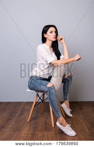 Beautiful Young Woman Posing And Leaning On Chair's Back