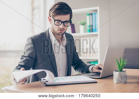 Portrait Young Handsome Businessman With Glasses Is Sitting At The Desk In The Office Workstation An