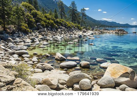 Beautiful boulders and crystal clear water of the lake Tahoe. Hidden Beach, Lake Tahoe - Nevada, USA poster