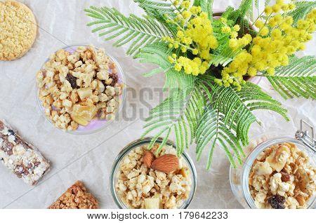Crunchy Muesli Bars With Yogurt And Mimosa Top View