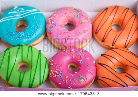 Colored Donuts With Glaze In A Box