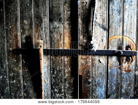 Old Simple bar lock on inside of dirty barn door