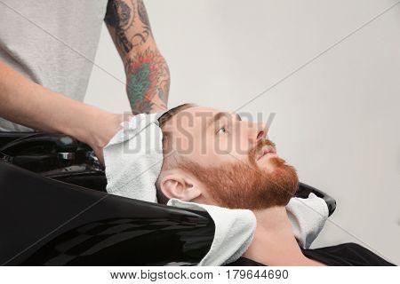 Drying hair with towel in barbershop
