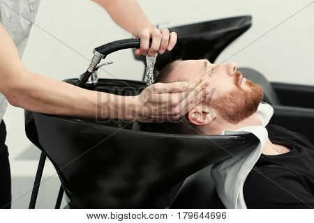 Washing hair in barbershop