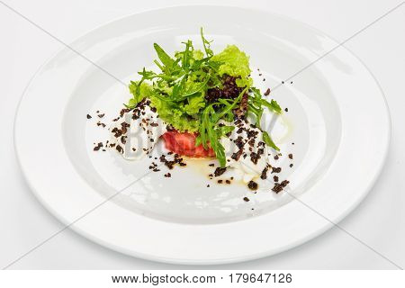 Vegetable salad with white sauce and grilled crumbs. Close-up, white background.