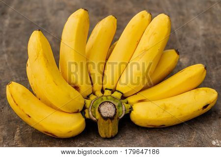 Bunch of bananas on old wood .